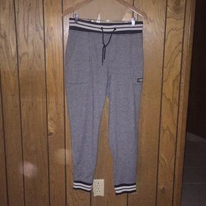 Gray Sweatpants with a White and Black Band